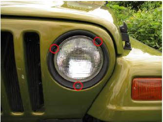remove the 3 t15 torx screws that hold the headlight trim bezel