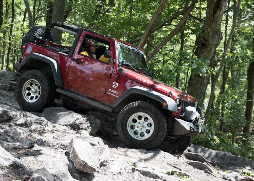 JK Wrangler Crawling Down a Rock Shelf