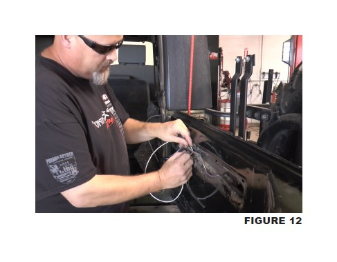 on the end of the jumper wire is passed through the hole in the sheet  metal to the interior of the tailgate, then plugged into the oe third brake  light