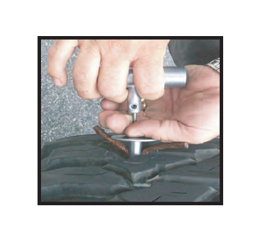 5 Press Down On Plunger Extractor And Pull Up T Handle To Insert Rubber Plug Into Tire