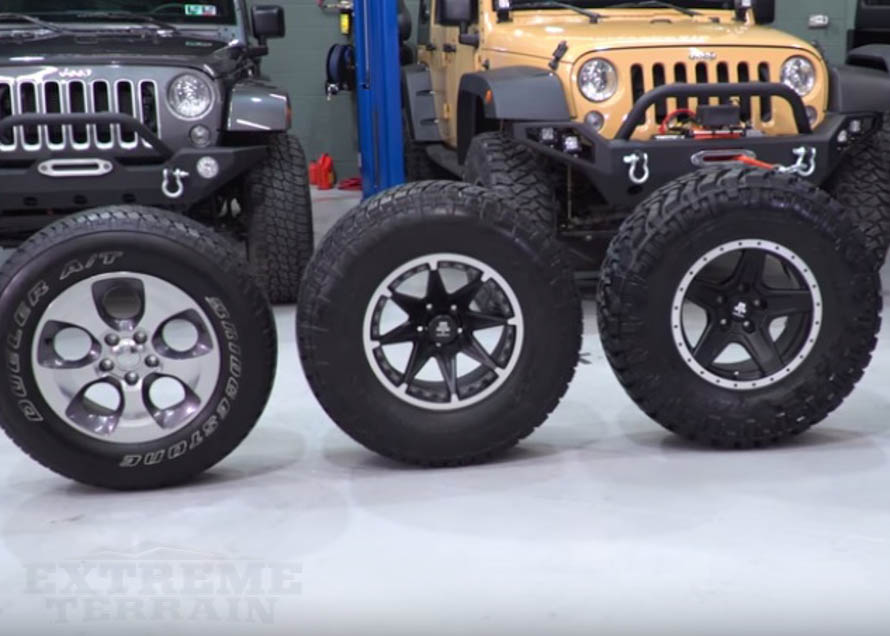 Various Tire Sizes In Front Of Two Wranglers