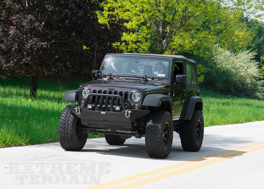 JK Wrangler Cruising Down the Road