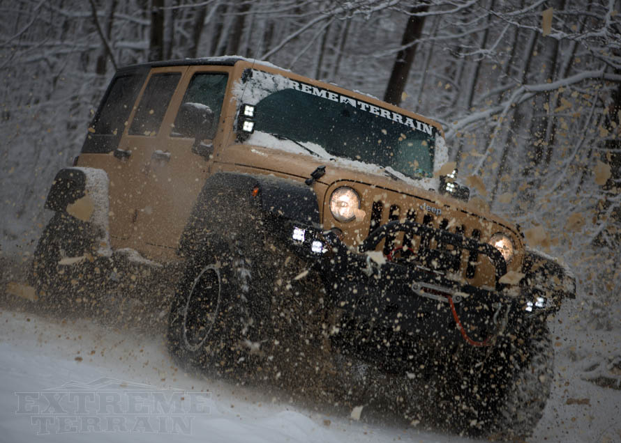 JK Wrangler Unlimited Tearing Up Snow and Dirt