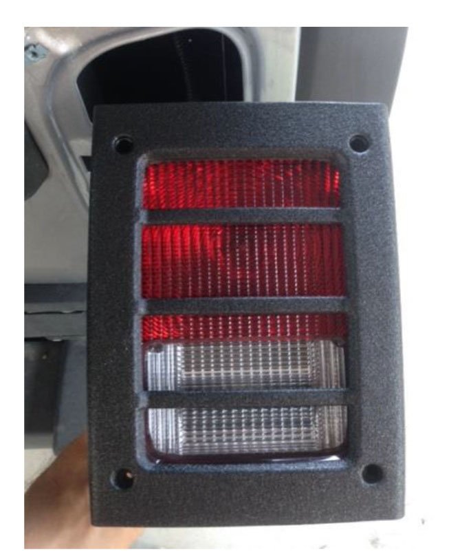 Keep the light facing up and place the guard over the light. Slide the screws into the holes to keep the rubber buffers in place.  sc 1 st  ExtremeTerrain & How to Install a Barricade Tail Light Guard - Textured Black On ... azcodes.com