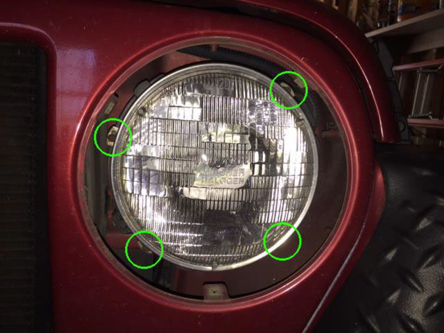 reach behind the headlight and disconnect the wiring harness